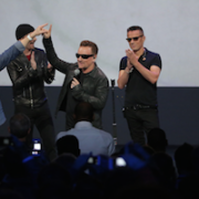 Bono presses the button with Zen Master Tim Cook